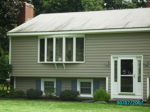 Standard vinyl Siding with old 3 tab roofing shingle